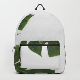 Green monstera leaves on white ink Backpack