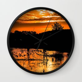 Silhouetted Canadian Geese taking a break in a pond in Ann Arbor, Michigan Wall Clock