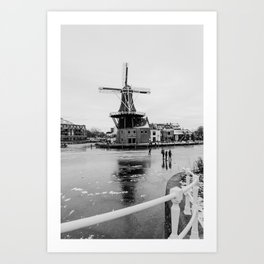 Iconic mill 'The Adrian' IV in black and white in Haarlem alongside a frozen Spaarne canal | Ice skating | Reflections | Architectural fine art print Art Print