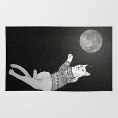 Cat trying to catch the Moon Rug