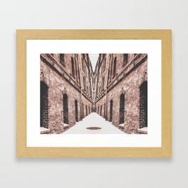 walkway in the middle of the brown brick buildings Framed Art Print