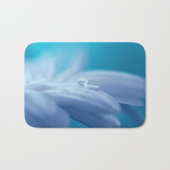 Lonely droplet on a daisy in blue  on #Society6 Bath Mat