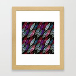 Multi colored feathers on black background . Framed Art Print