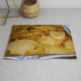 Chips in aluminum paper bag, food photography Rug