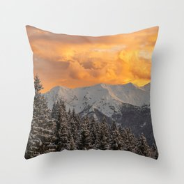Orange clouds above mountains and spruce forest Throw Pillow