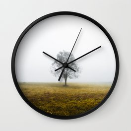 Lonely tree in a foggy autumn morning Wall Clock
