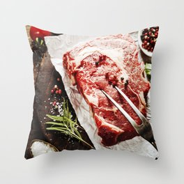 Raw beef steak with meat fork and ingredients on wooden background Throw Pillow