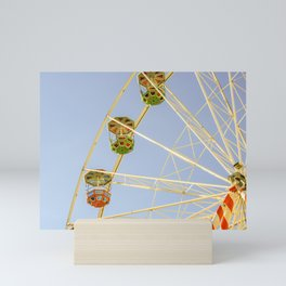 Ferris wheel in a luna park in a sunny day Mini Art Print