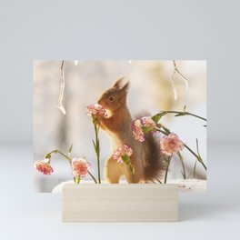 squirrel on ice with flowers Mini Art Print