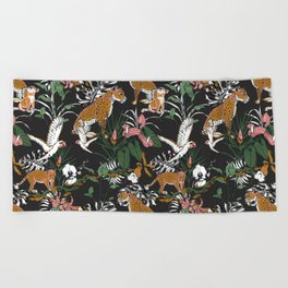 Leopards at night Beach Towel