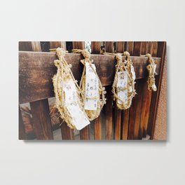Traditional Japanese Straw Slippers with Prayers Hanging From Wooden Fence at Temple. Metal Print
