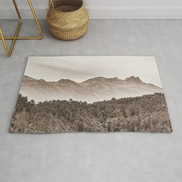 The mountain beyond the forest Rug