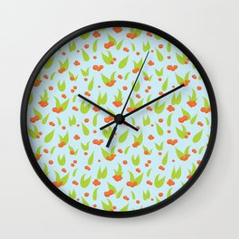 Rowan berries on blue background Wall Clock