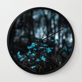 Blue Wildflowers in a Forest Wall Clock