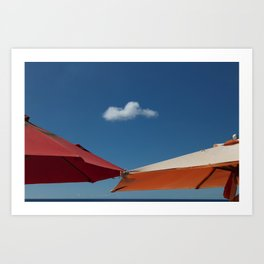A solo cloud and parasols Art Print