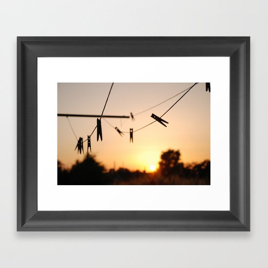 Swallows on a wire Framed Art Print