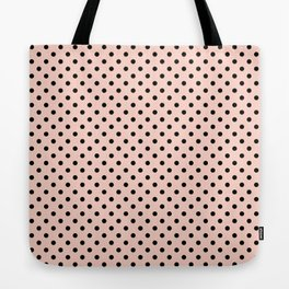 Small black polka dots on a pink beige background. Tote Bag