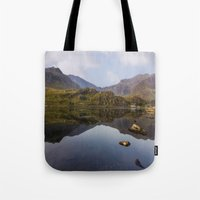 Tote Bags featuring Morning Reflections by Ian Mitchell