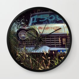 1959 Plymouth in the weeds. Wall Clock