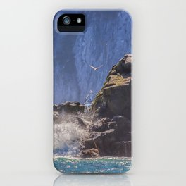 Small boat and waves crashing over rocks iPhone Case