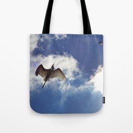 Egrets soaring against blue sky Tote Bag