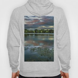 Photograph of a beautiful sunset over pond, with reflecting sky. Hoody