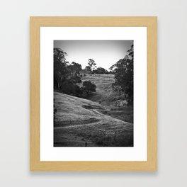 A track winding back Framed Art Print