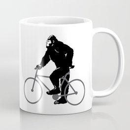 Bigfoot  riding bicycle Coffee Mug