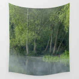 Photograph of mist on water, with woodland on the shore. Wall Tapestry