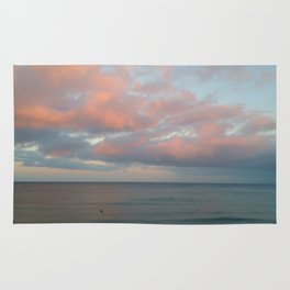 pink clouds over troubled water Rug