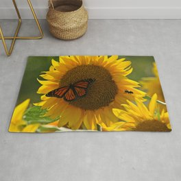 The butterfly the bee and the sunflower Rug