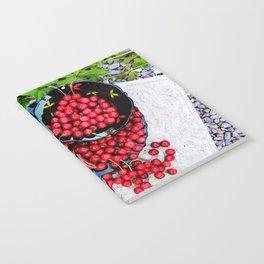 Cherries on black plates Notebook