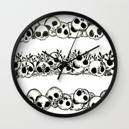 several piles of skulls Wall Clock