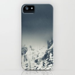 Darkness and clouds covering mountain iPhone Case