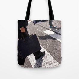 Group of businessmen and women walk along crosswalk in Shinjuku, Tokyo, Japan Tote Bag