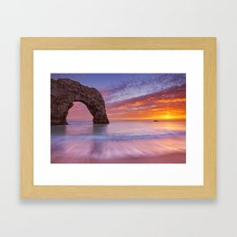 Durdle Door rock arch in Southern England at sunset Framed Art Print