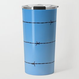 Contseptual shot of barbed wire over blue sky Travel Mug