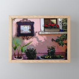 Flowers, old world buildings and a knick-knack rack. Framed Mini Art Print