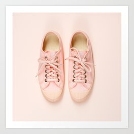 Pink canvas sneakers on pink background, close up Art Print