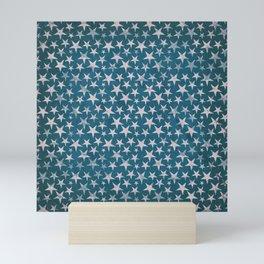 White stars on grunge textured blue background Mini Art Print