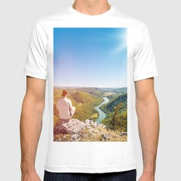 Rear view men looking at Ain valley mountains in summer T-shirt