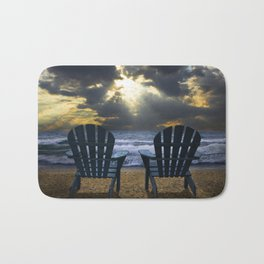 Two Adirondack Deck Chairs on the Beach with Waves crashing on the Shore Bath Mat