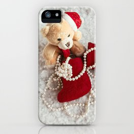 A soft bear toy on the snow background iPhone Case