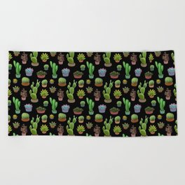 Potted cacti and succulents on black background Beach Towel
