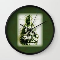 budi satria kwan Wall Clocks featuring Antique Green Kwan Yin by Jan4insight