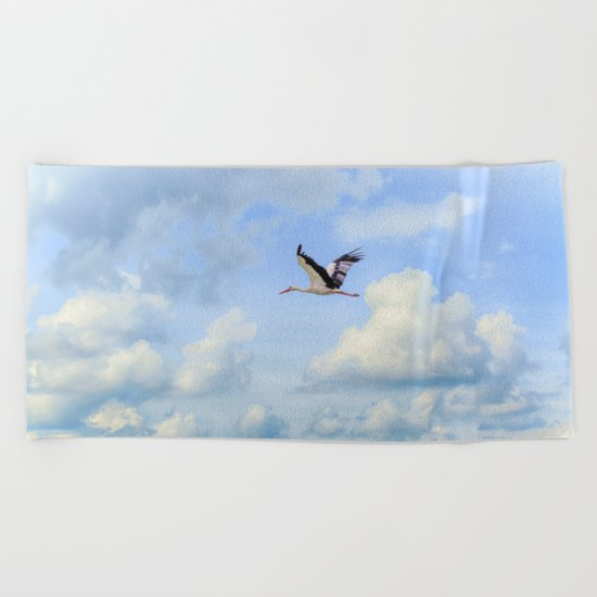 Flying stork Beach Towel