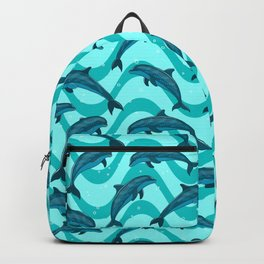 A flock of dolphins in the sea. Marine seamless pattern. Backpack