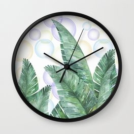 Banana leaves on the decorative background. Wall Clock
