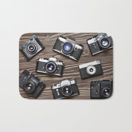 Collection of retro photo cameras on  wood Bath Mat