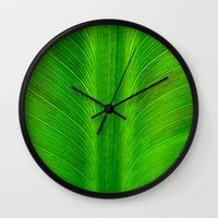 banana leaf Wall Clocks featuring Banana Leaf by moo2me